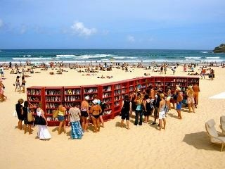 Library on a beach! This is brilliant for seaside towns! Move a small library to the beach, how wonderful! My mom would be in heaven!