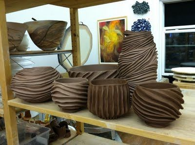 coils on outside of pots to create interesting surface design.