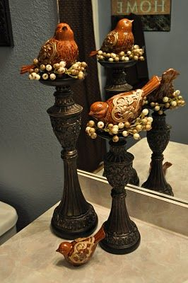 All that you need are a couple of candlesticks, some greenery, pretty birds and a glue gun. How charming!