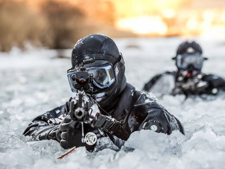 ROK Army Special Forces members emerge from a frozen river during cold weather training