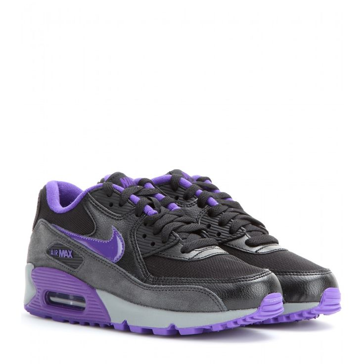 The Nike Air Max 90 Essential sneakers have attained cult status. This pair  has been reworked in black and charcoal grey with hints of bright purple.