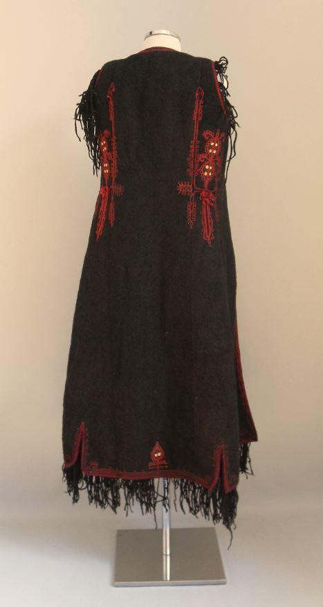 """Flokata"". Overcoat. Lefkada, Ionian Islands, Greece. Early 20th century. H. 1.25 m. Peloponnesian Folklore Foundation Collection, Nafplion. Donated by Elina Karmokolia. 2010.6.788. ""Flokata"". Sleeveless black overcoat made of fulled wool with tan,..."