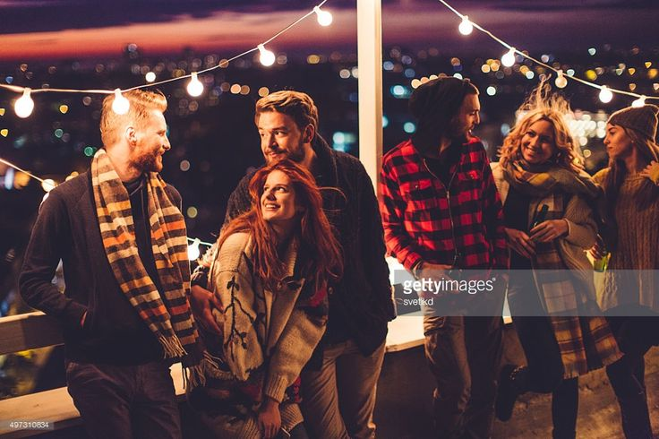 Stock Photo : Group of friends at rooftop party More