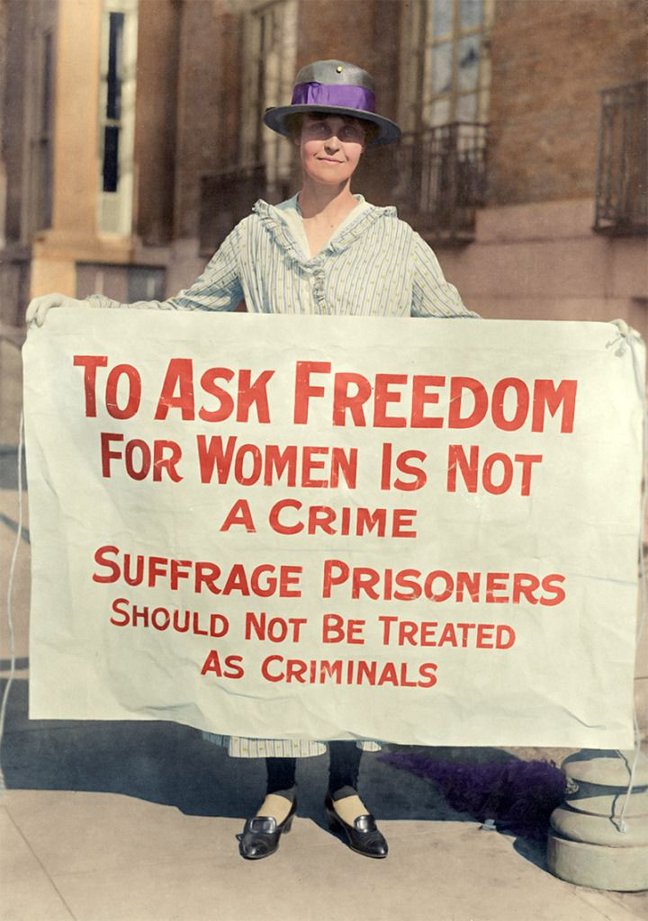Mary Winsor, founder and president of the Limited Suffrage Society, holds a sign during the American suffrage movement; (ca. 1917) (Colorized)