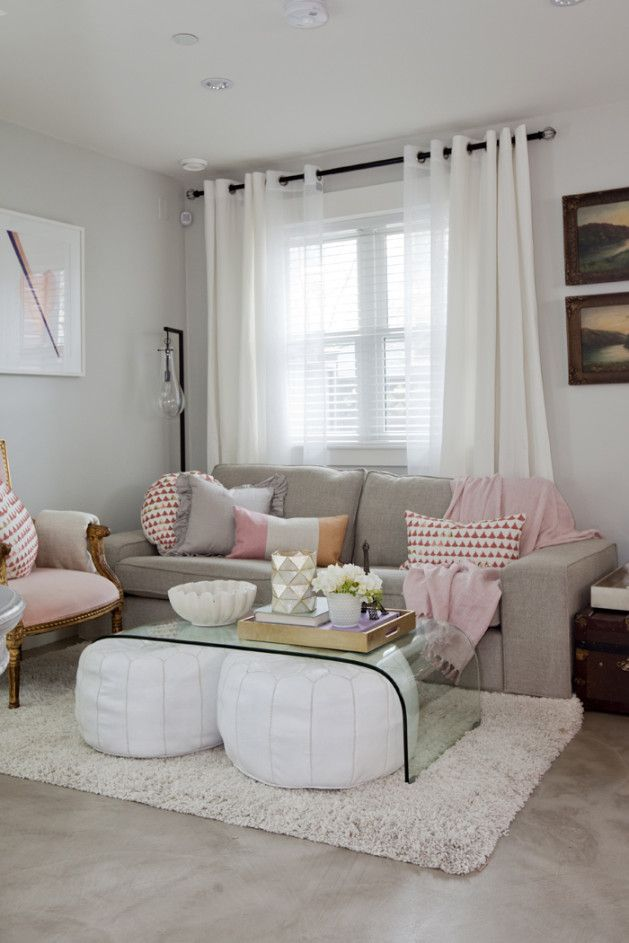 gray pink living room with white poufs under glass coffee table