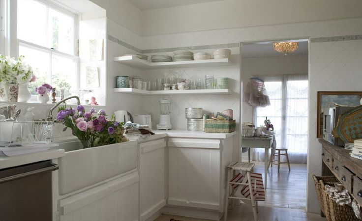 diagonally laid tile, garden gate-like cabinet fronts plus additional rustic-flavored storage