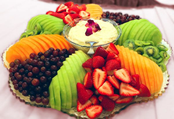 Fruit Tray- I like the way the melon is laid out. Much faster cutting and yet more artistic presentation. Win/win!