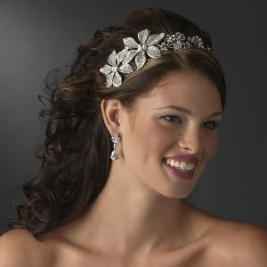 Immaculate Antique Silver Side Accented Flower Headpiece. An array of petite shining flowers lead up to two large side accented flowers adorned with sparkling clear crystals. Unique and mesmerizing, this headpiece will look enchanting on any classic, modern or vintage inspired bride and will coordinate perfectly with a white or ivory wedding dress http://oneclassicwedding.com/For-The-Bride/Bridal-Tiara-Headband/Side-Accented-Flower-Headpiece