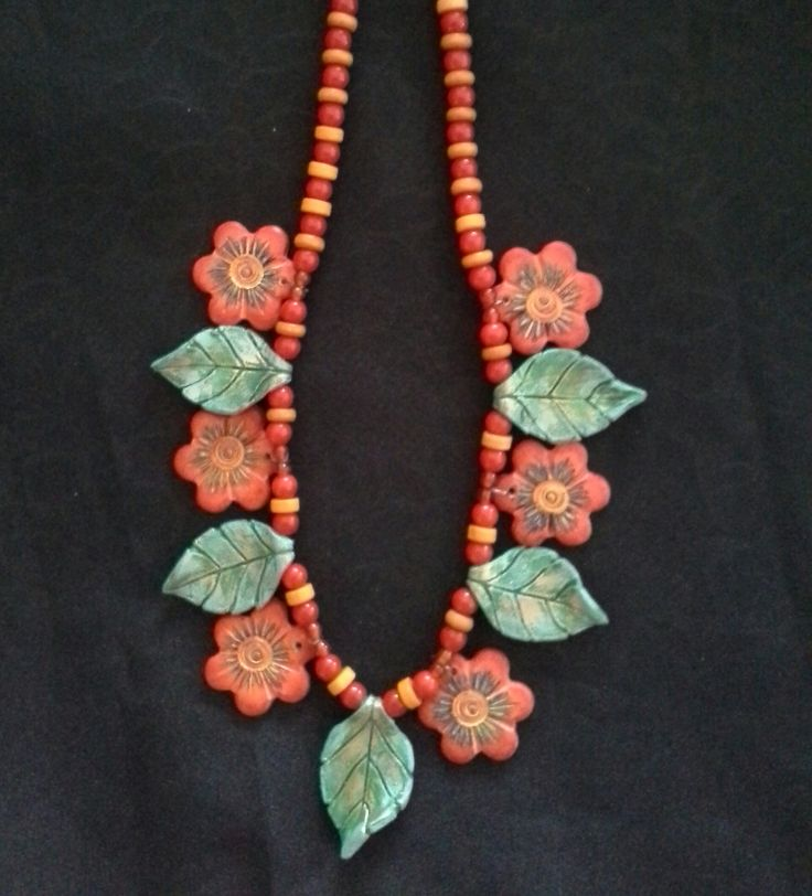 Necklace made from Polymer clay, pastels and pencils.