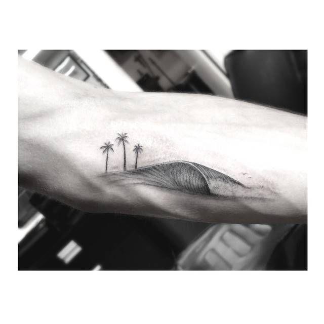 Single needle wave tattoo on the inner forearm.