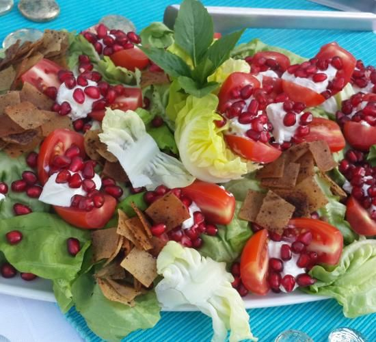 Labneh*, tomato and pomegranate salad ...a lovely combination with the sweet pomegranate seeds, tangy cherry tomatoes and labneh with the crunchy toasted Arabic bread. *You can substitute goat cheese for the labneh