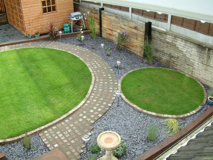 pair of new separate circular lawns show potential for distinct areas once screening planting grows - Lawn Design Ideas