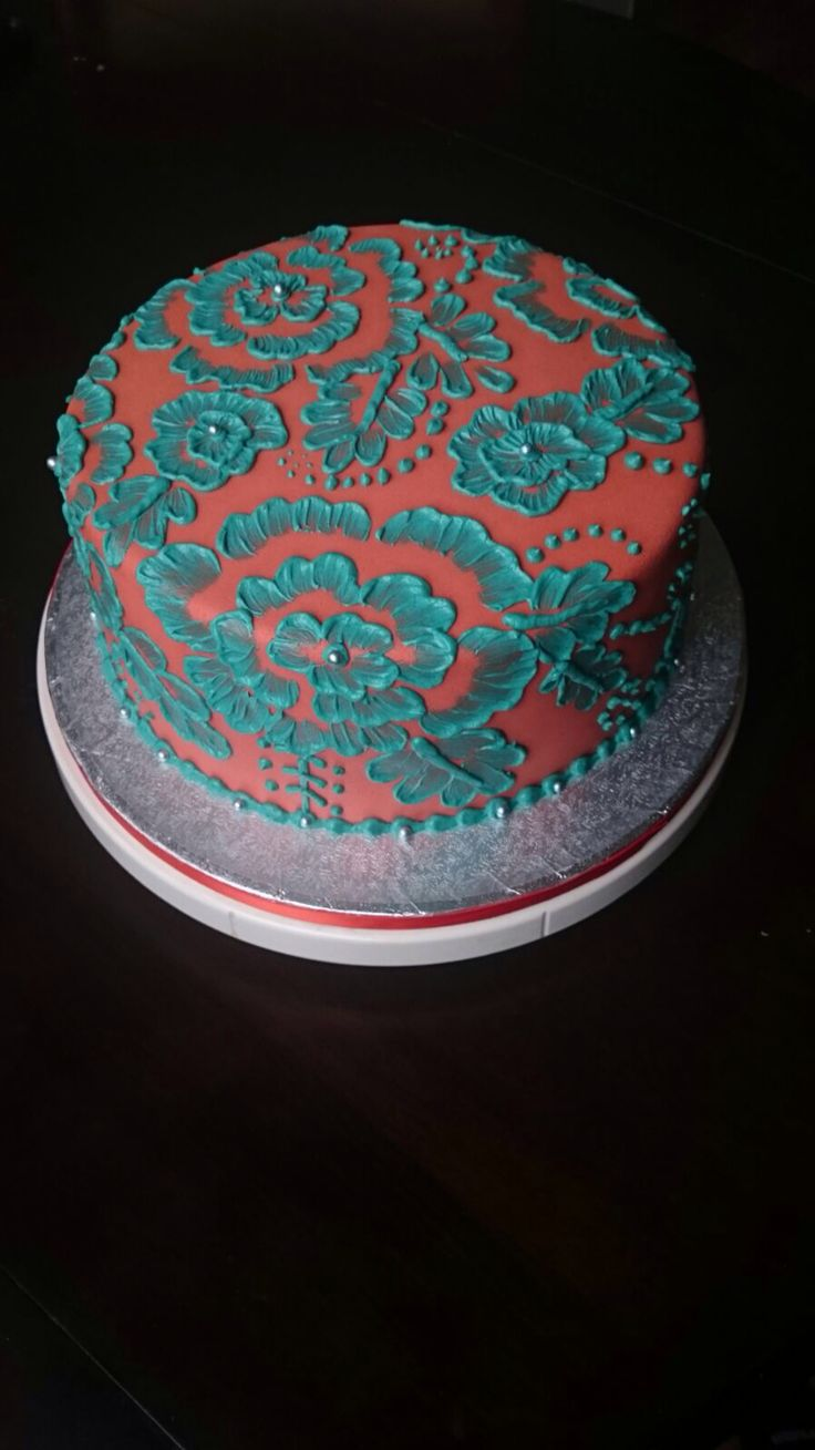 Coral and teal brush embroidery cake