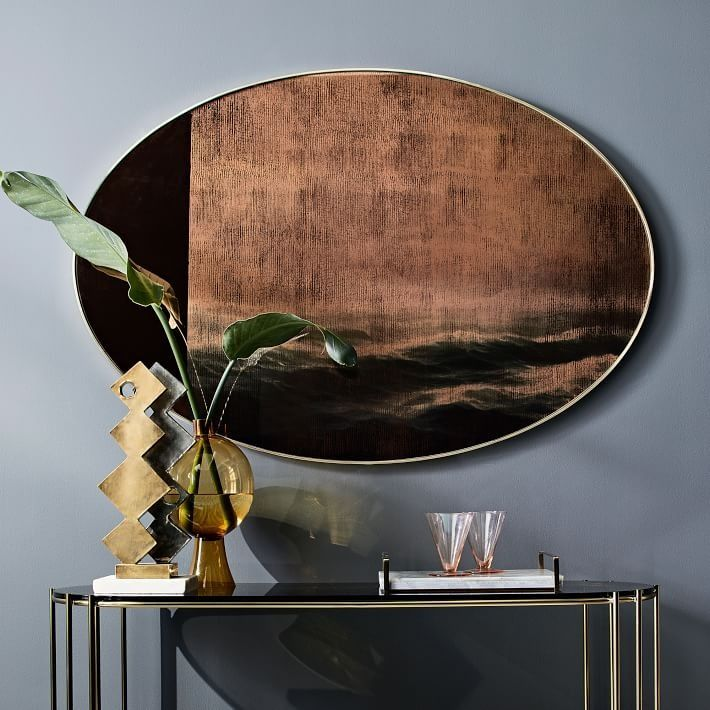 We can't take our eyes off this wall mirror, featuring a scenic ocean vista splashed across colored glass for a new take on traditional landscapes. It's part of west elm Collection—a carefully curated mix of pieces that inspire and transform your space.