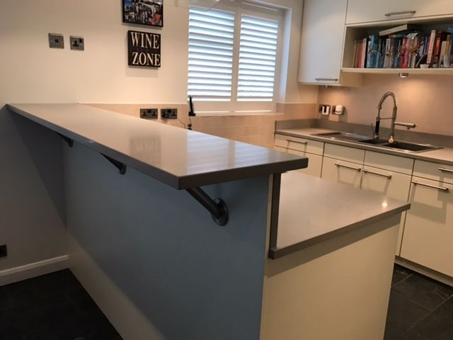 Quartz Worktops With Raised Breakfast Bar And Chrome Leg