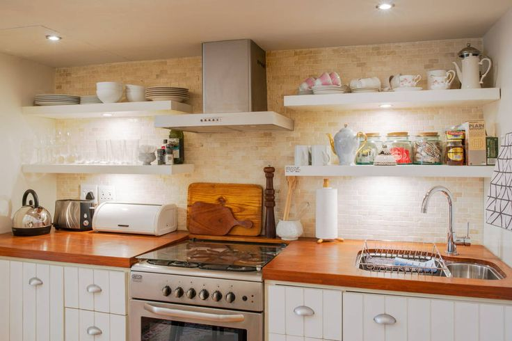 The compact kitchen contains everything you could need, including a dishwasher, washing machine, gas stove and oven.