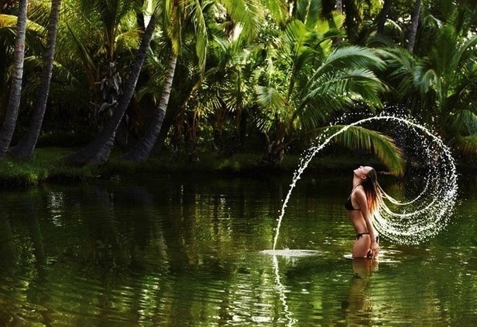 flipping Hair in water... throw head back makes perfect circle of hair and water beautiful women with long hair, and men with long beards can do this also
