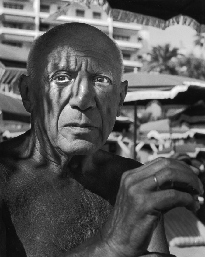 Pablo Picasso sitting outdoors on a patio without a shirt in 1962. (Photo by Horst Tappe/Hulton Archive/Getty Images