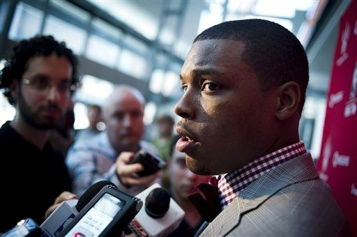 Toronto Raptors new NBA basketball player Kyle Lowry answer questions following during a news conference in Toronto, Tuesday, July 17, 2012. Lowry was acquired last week in a trade with the Houston Rockets. (AP Photo/The Canadian Press, Ian Willms)