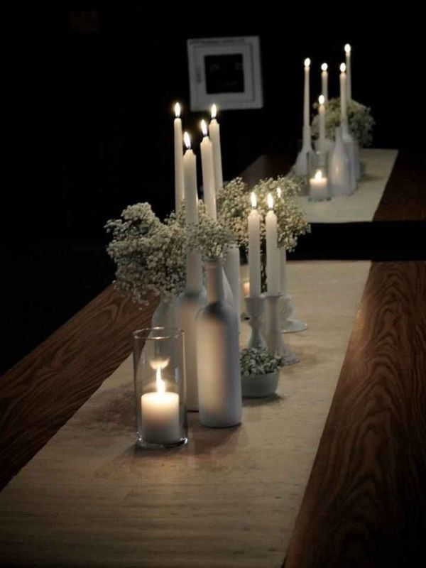 White bottle centerpieces--this would be cute and inexpensive!