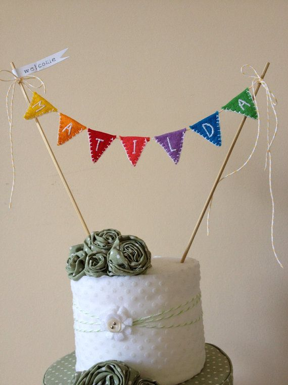 Rainbow cake bunting/garland perfect for a new baby or kids birthday party by Vintage Magpie