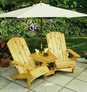 Free Double Adirondack Settee Plans.  This is a nice plan if you have the space.  If you make these according to plan it is a rather large piece. Comfortable with a ton of function (table, umbrella)
