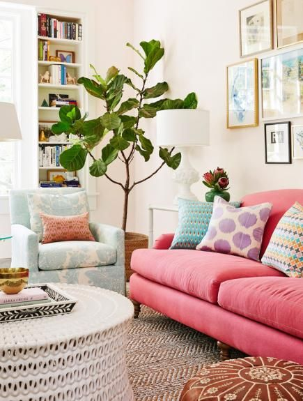 In the sunroom, a patterned aqua chair next to a perky pink sofa creates playful contrast. Soft pink paint on walls works as a warm neutral. More photos from this St. Louis home: http://www.midwestliving.com/homes/featured-homes/house-tour-balancing-act?page=12