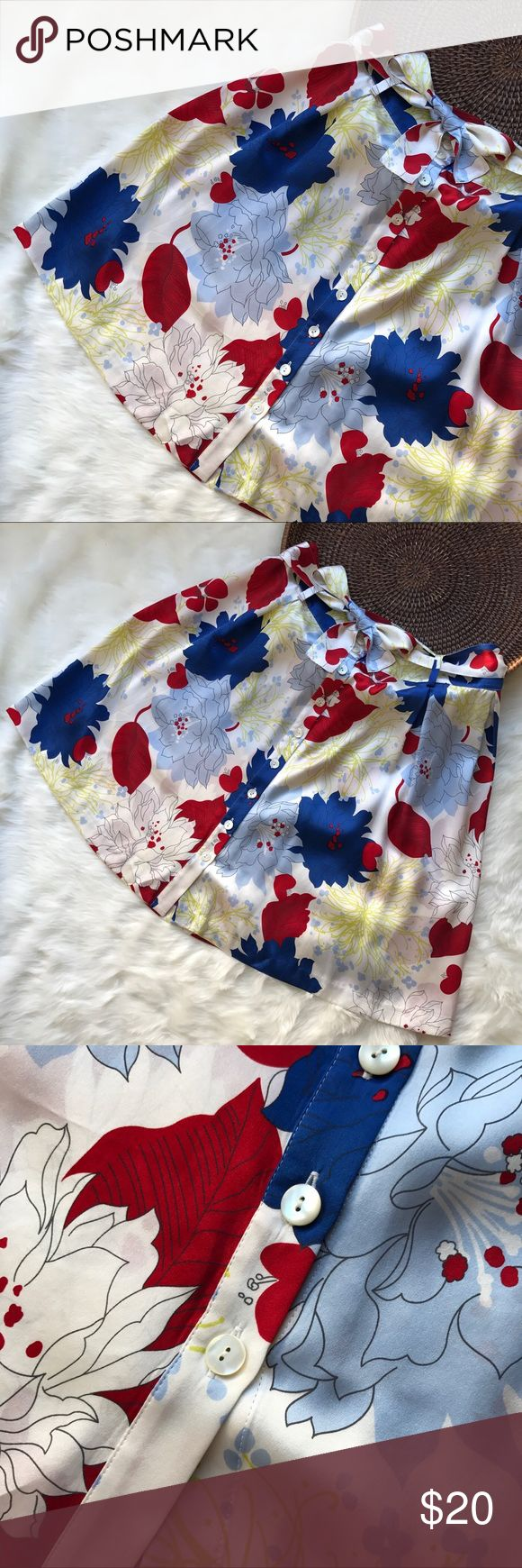 "H Tommy Hilfiger Colorful Floral Button Skirt SZ 4 H Tommy Hilfiger Colorful Floral Button Skirt Size 4. Button closure on side. Matching silk belt. 100% silk with no lining, is see through. Vibrant blue, red, white floral pattern. Perfect for work or outdoor parties.  Belt has four small holes pictured on two on either end of belt. Waist 15"" across flat. Length 21"" Tommy Hilfiger Skirts Mini"