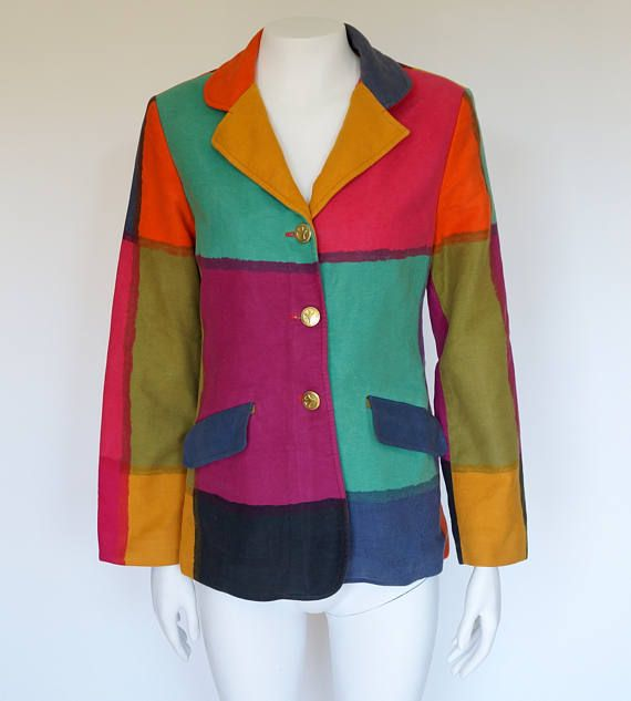 Hello Im glad youre here PANDORA FASHION shop  I offer vintage MOSCHINO JEANS jacket Made in Italy color: multicolor Cheap & Chic logged buttons. 1 extra button 100% cotton/flannel lining 67%acetate 33% rayon size on tag I42 USA8 F38 GB12 D38 used in very good vintage condition   total length 68 cm/26,77 inch width shoulders 41cm/16,14 inch width armpit to armpit 48 cm/18,90 inch length sleeves 61 cm/24,02 inch length sleeves from armpit 43 cm/16,93 inch   If...