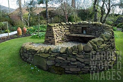STONE_BENCH_SCULPTURE__SHEPHERD_HOUSE_INVERESK_SCOTLAND__OWNERS_SIR_CHARLES_AND_LADY_FRASER