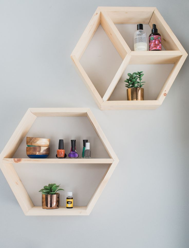 East Coast Creative and team used scrap wood to build geometric shelves for her master bathroom makeover.