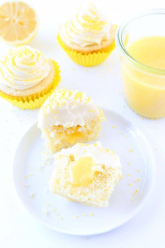 Lemon Curd Cupcakes Recipe on twopeasandtheirpod.com Lemon cupcakes filled with lemon curd and topped with buttercream frosting. These are the BEST cupcakes!