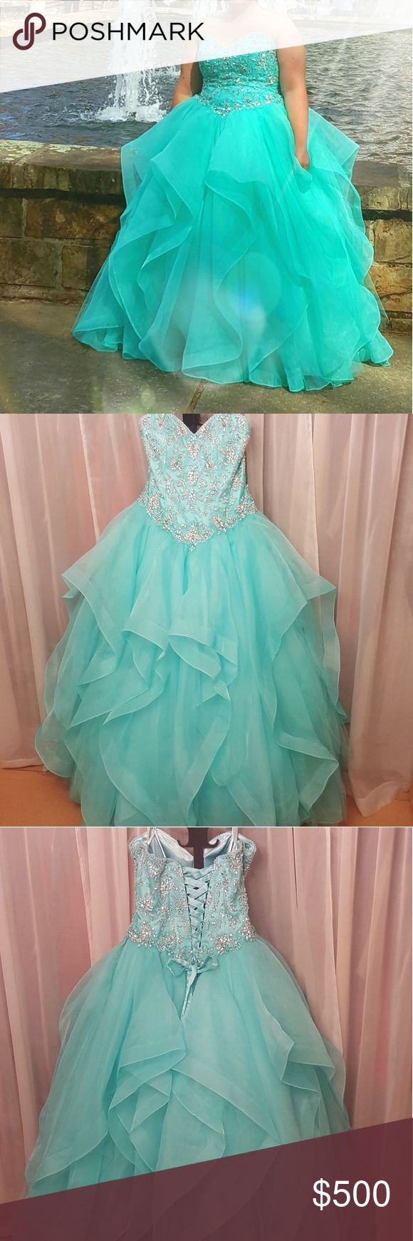 Gorgeous prom dress! Beautiful light teal color. Worn only for 3 hours at the most! Excellent condition! Fully lined with layers of tulle. Lots of beadwork on front and back of bodice! Can make smaller (14) or larger (18) with adjustable corset in back! Paid 700$ for it brand new! Asking 500$ obo! Dresses Prom