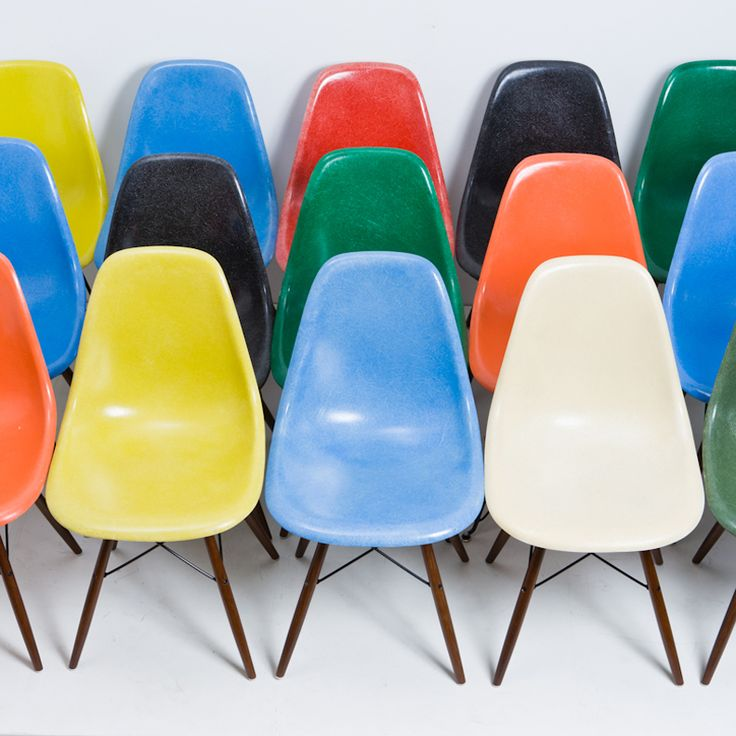 Eames dowel base fiberglass side chairs.