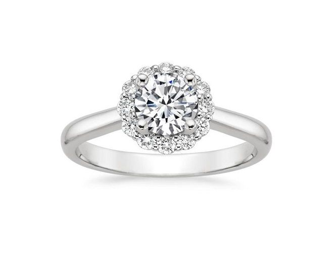 ''Gitan''Halo Flower Diamond Engagement Ring A subtle floral diamond halo blooms around the center diamond in this exquisite ring.
