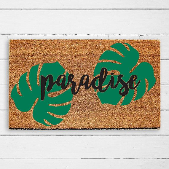 """Add some paradise to your home with this tropical doormat!  This unique hand painted doormat is great for making a statement at the front door. The door mat is made from coir, a natural renewable material made of coconut fibers, providing a sturdy and mold resistant surface. The mat is tan in color, has a sturdy PVC backing, weighs around 5 lbs and measures 18x30""""  #doormat #homedecor #paradise #calligraphy"""