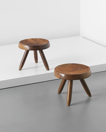 CHARLOTTE PERRIAND AND PIERRE JEANNERET  Pair of three-legged stools, from the l'Equipement de la Maison series, designed 1949. / Phillips