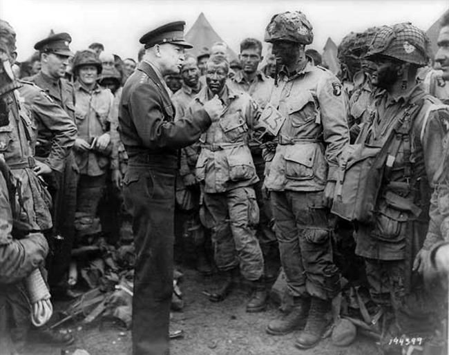 General Dwight D Eisenhower talking to paratroopers just before they are dropped behind enemy lines at Normandy for the D-Day invasion  -  1944
