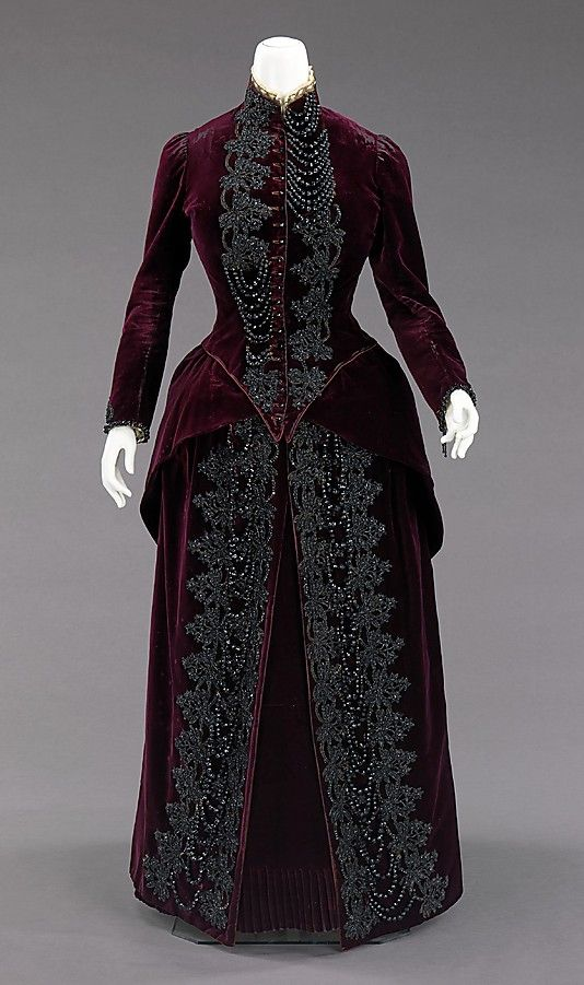 """Ensemble, Mme. Uoll Gross: ca. 1885, American, silk/synthetic/jet/feather.     """"This dress was designed to be worn in an open top carriage which, at the time, was a social event and everyone had to dress the part.    The bustle silhouette, although primarily associated with the second half of the 19th century, originated in earlier fashions as a simple bump at the back of the dress, such as with late 17th-early 18th century mantuas and late 18th- early 19th century Empire dresses. The…"""