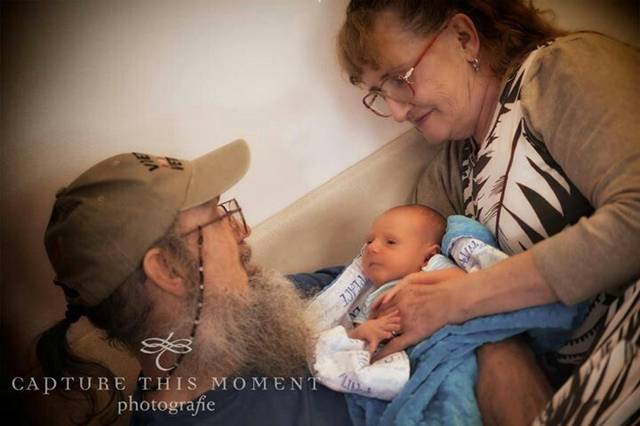 Si and his wife, and their new grand-baby!