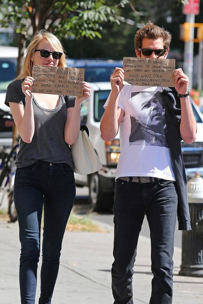 """Emma Stone Andrew Garfield Photos - Emma Stone and Andrew Garfield send a message through waiting papparazi hand written on brown paper bags. The paper bags read """"We just found out that there are paparazzi outside the restaurant we were eating in. So .. why not take this opportunity to bring attention to organizations that need and deserve it? Have  great day !"""" with addresses to two charities, Wolrdwide Orphans Foundation and Gilda's Club New York City. - Emma Stone and Andrew Garfield…"""