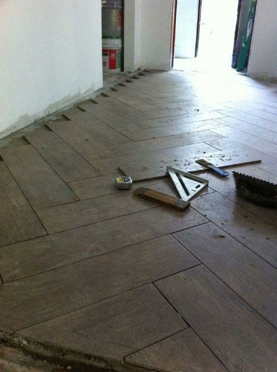herringbone for the kitchen floor - with porcelain tile that looks like wood