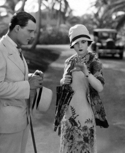 Olive Borden and Neil Hamilton in The Joy Girl