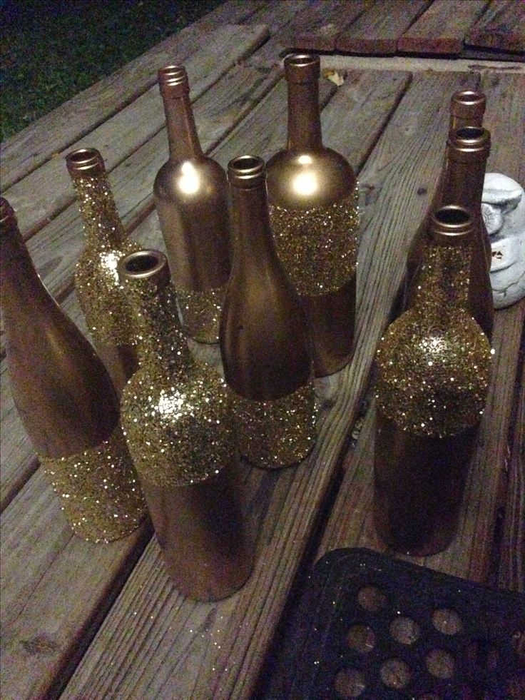 These painted and glittered wine bottles are so adorable! It fits the theme of the Williamsburg Winery's Summer Solstice Celebration on June 27, 2014