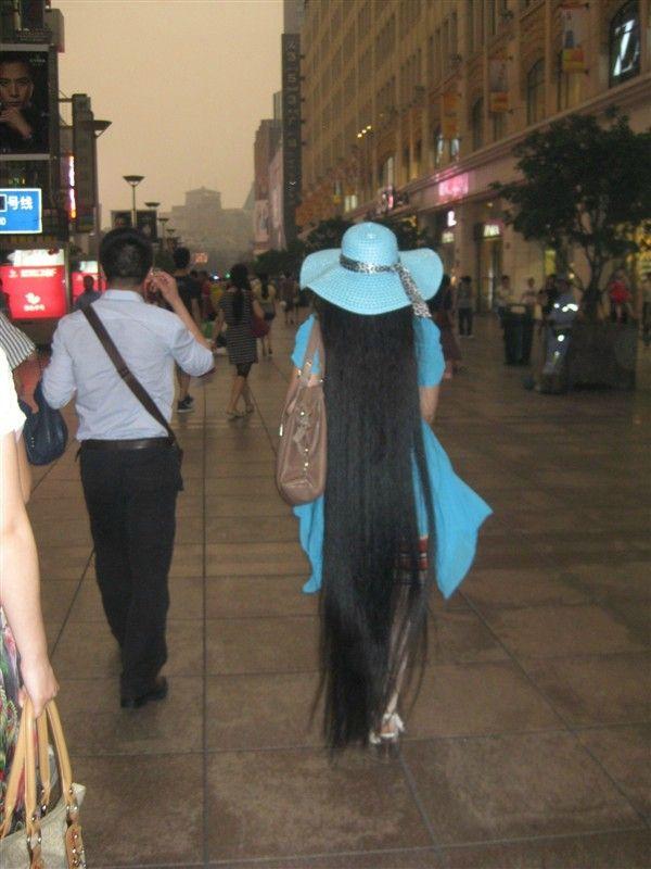 Chen Juan Walked With Floor Length Long Hair On Street