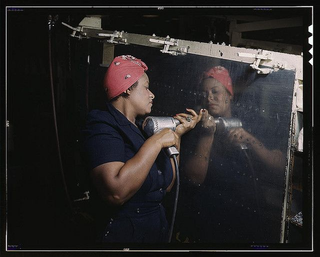 """Operating a hand drill at Vultee-Nashville, woman is working on a """"Vengeance"""" dive bomber, Tennessee (LOC) by The Library of Congress, via Flickr"""