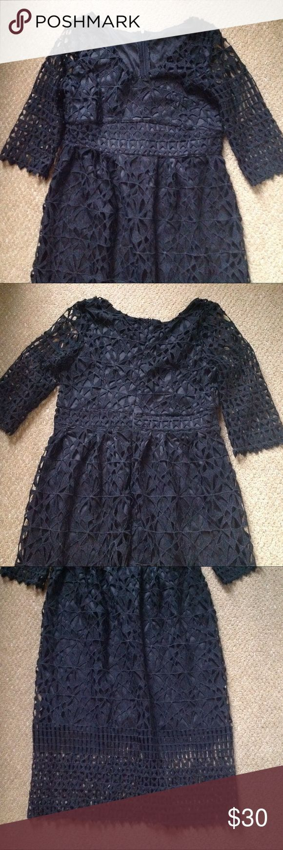 Black Geometric cutout lace dress A very edgy and modern take on a lace fitted d…