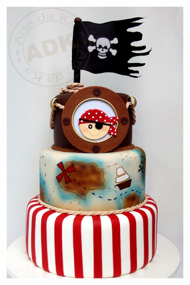 Three tier pirate cake. The tattered jolly roger crossbones flag creates a great sense of motion.