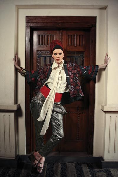 Satin ethnic-design jacket, white cotton shirt with extra-long neck-tie and red obi by Deden Siswanto. Spandex silver balloon pants by Lenny Agustin. Vintage-style bangles by Aldo. Silver strappy wedges by Everbest. Headwear from Aquila Asia wardrobe.