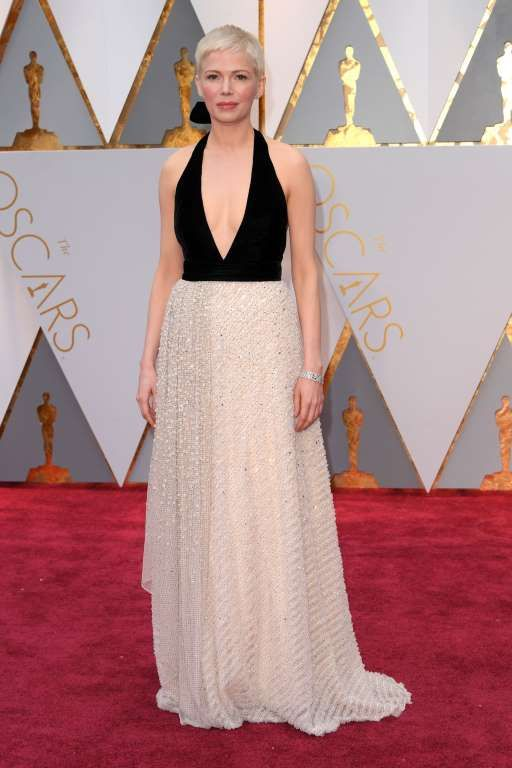 Fashion hits and misses from the 2017 Academy Awards  -  February 27, 2017   Seeing double! Michelle Williams arrived in this lackluster gown, which looked like a less‐glam version of Emma Roberts' vintage Armani  Prive look. Michelle's, by Louis Vuitton, fell flat with its velvet bodice and its boring, beaded ivory skirt.